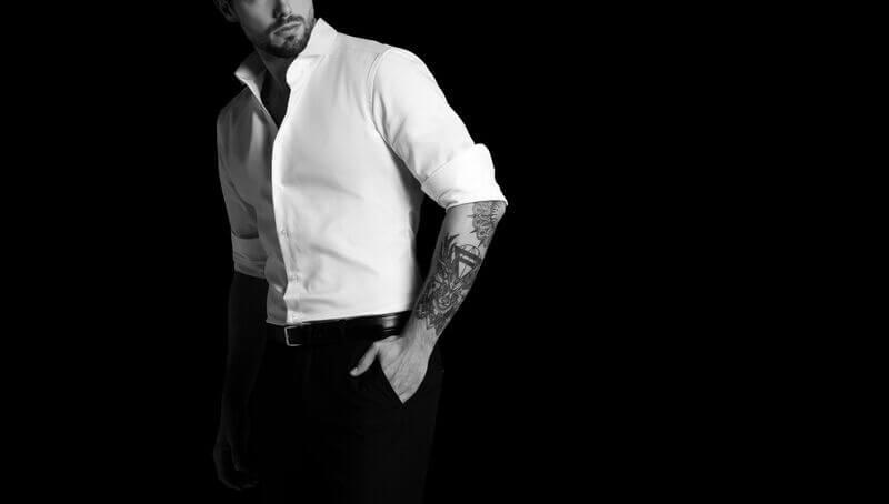 Model Posing in Smart Attire With Tattoos
